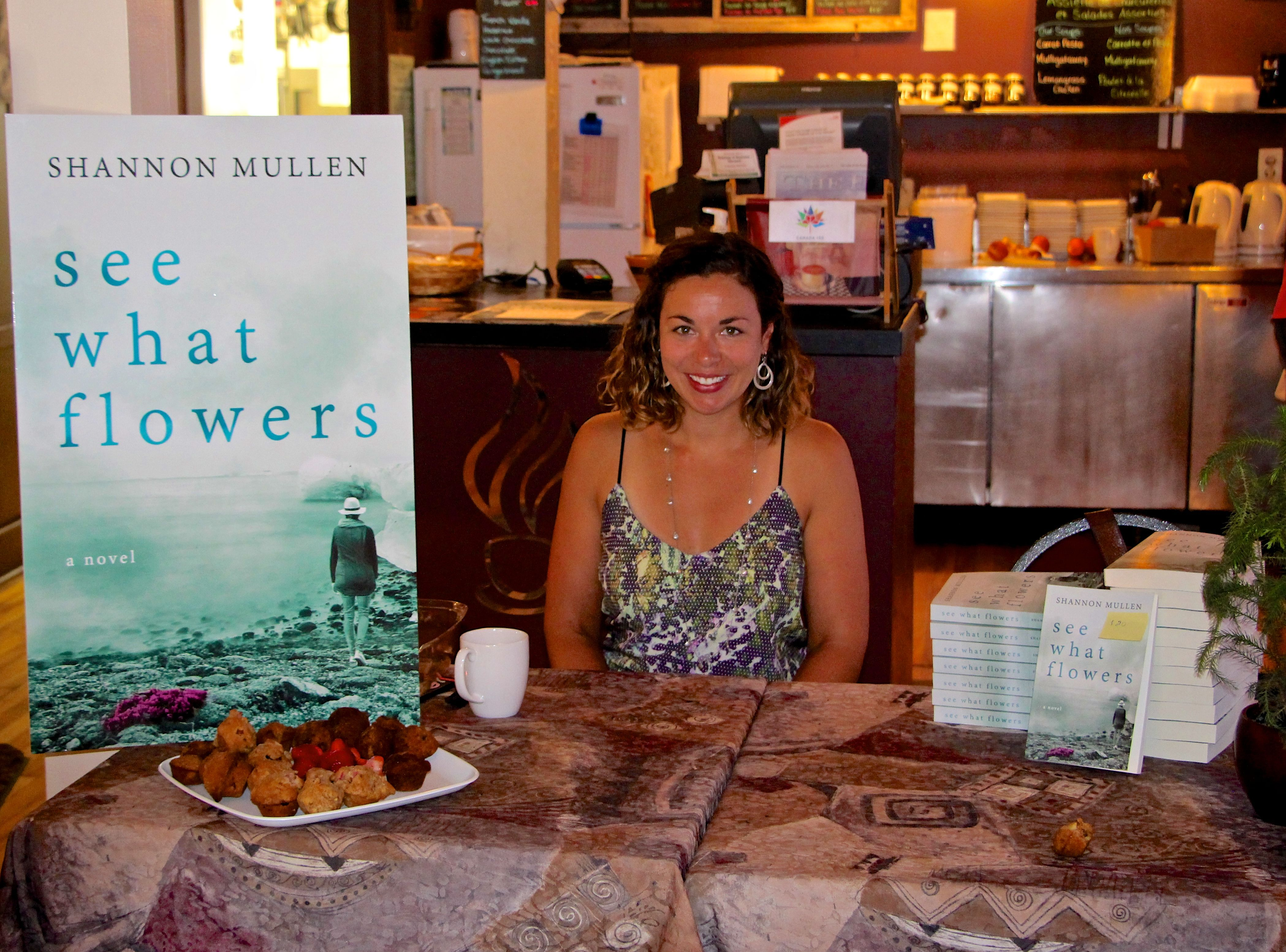 signing books at cafe 349